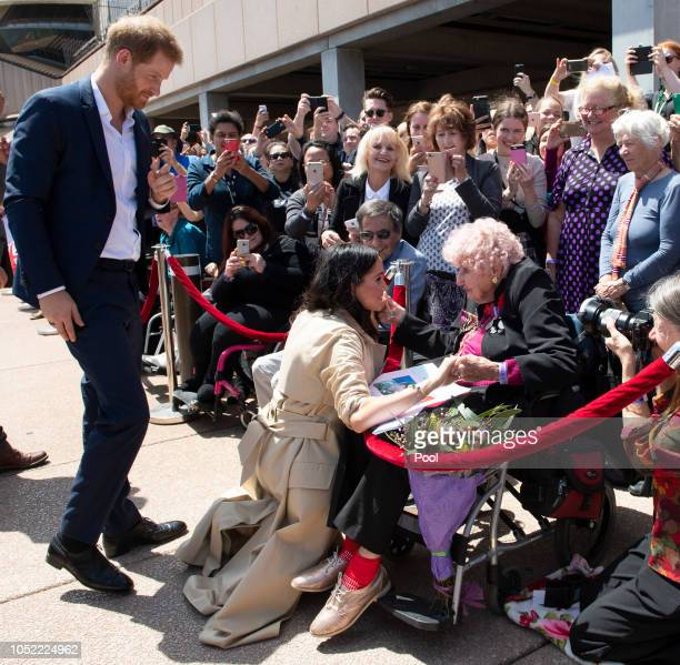 Prince Harry Duke of Sussex and Meghan Duchess of Sussex meet 98 year old Daphne Dunne during a meet and greet at the Sydney Opera House on October...