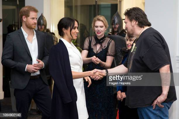 Prince Harry Duke of Sussex and Meghan Duchess of Sussex meet Creative Art Director at Weta Digital Gino Acevedo during a visit to Courtney Creative...
