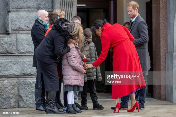 Prince Harry Duke of Sussex and Meghan Duchess of Sussex meet wellwishers as they visit a new statue to mark the 100th anniversary of the death of...
