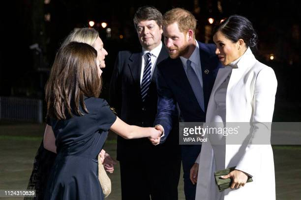 Prince Harry Duke of Sussex and Meghan Duchess of Sussex meet guests as they arrive to attend a gala performance of 'The Wider Earth' in support of...