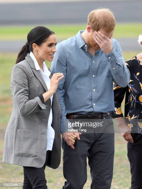 Prince Harry Duke of Sussex and Meghan Duchess of Sussex meet local community members as they attend the naming dedication and unveiling of a new...