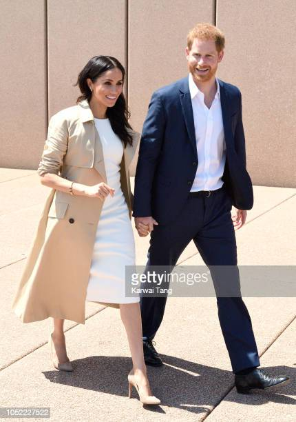 Prince Harry Duke of Sussex and Meghan Duchess of Sussex meet members of the public outside the Sydney Opera House on October 16 2018 in Sydney...