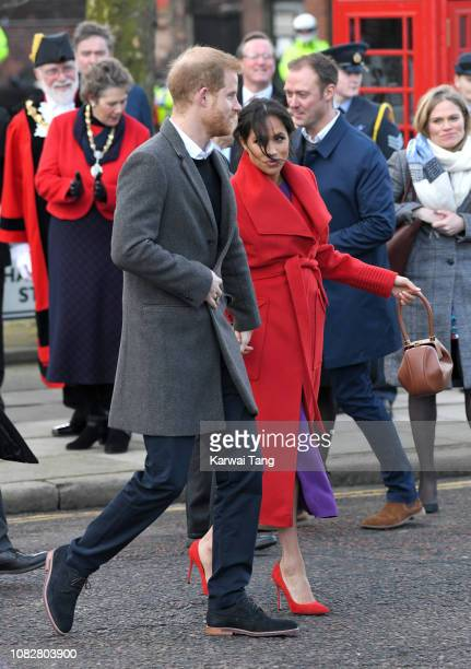 Prince Harry Duke of Sussex and Meghan Duchess of Sussex meet members of the public during a visit of Birkenhead at Hamilton Square on January 14...