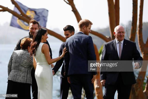 Prince Harry Duke of Sussex and Meghan Duchess of Sussex meet participants of the Invictus Games with Australia's Governor General Peter Cosgrove and...