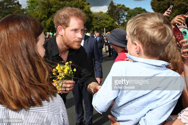 Prince Harry Duke of Sussex and Meghan Duchess of Sussex meet the public on a walkabout at Rotorua Government Gardens New Zealand on October 31 2018...