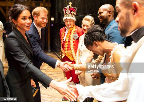 Prince Harry Duke of Sussex and Meghan Duchess of Sussex meet the cast and crew of 'Hamilton' backstage after the gala performance in support of...