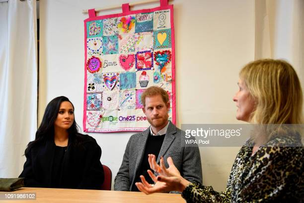 Prince Harry, Duke of Sussex and Meghan, Duchess of Sussex meet the charity CEO Anna Smith during a visit to One25, a charity specialising in helping...