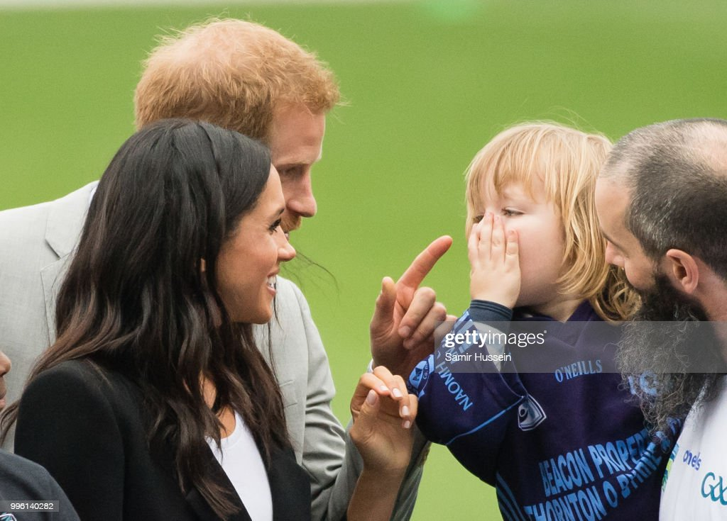 Prince Harry, Duke of Sussex and Meghan, Duchess of Sussex meet Walter Cullen, aged 3 at Croke Park, home of Ireland's largest sporting organisation, the Gaelic Athletic Association in Dublin, Ireland.