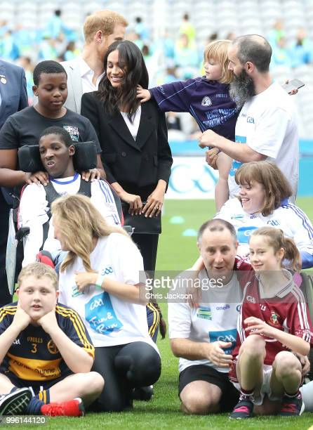 Prince Harry Duke of Sussex and Meghan Duchess of Sussex meet Walter Cullen aged 3 at Croke Park home of Ireland's largest sporting organisation the...