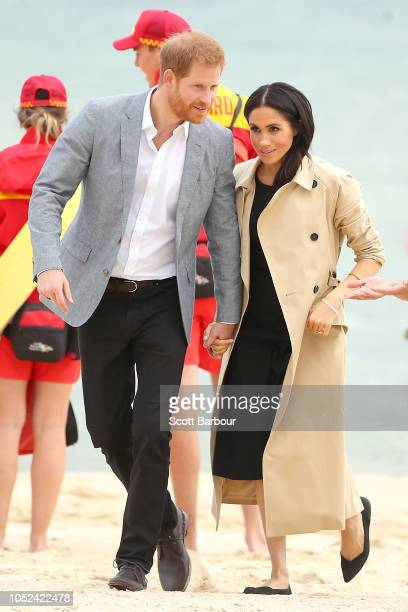 Prince Harry, Duke of Sussex and Meghan, Duchess of Sussex meet with lifeguards on October 18, 2018 in Melbourne, Australia. BeachPatrol is a network...