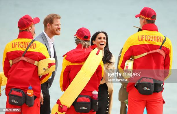 Prince Harry Duke of Sussex and Meghan Duchess of Sussex meet with lifeguards at South Melbourne Beach on October 18 2018 in Melbourne Australia...