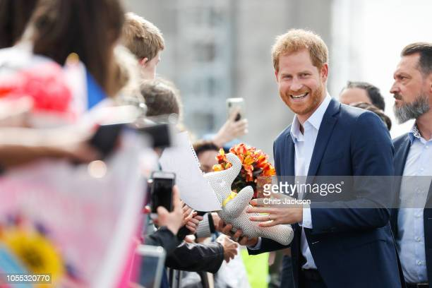 Prince Harry Duke of Sussex and Meghan Duchess of Sussex meeting and greeting fans along the street during 'Walkabout' on October 30 2018 in Auckland...