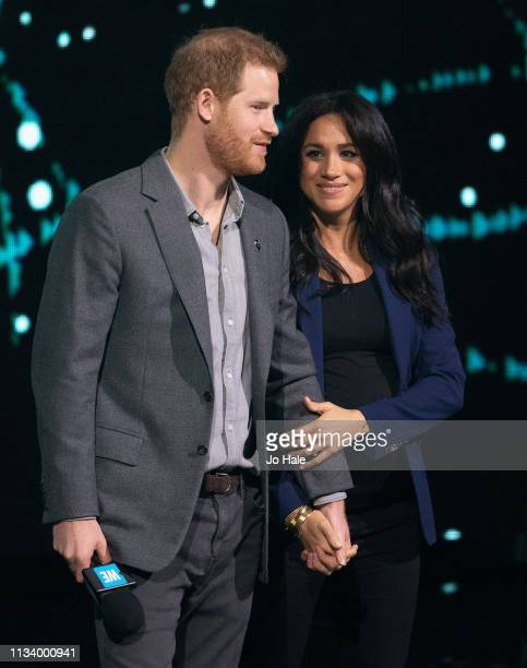 Prince Harry Duke of Sussex and Meghan Duchess of Sussex on stage at We Day UK at SSE Arena on March 06 2019 in London England