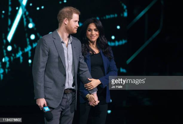 Prince Harry Duke of Sussex and Meghan Duchess of Sussex onstage at We Day UK at SSE Arena Wembley on March 06 2019 in London England
