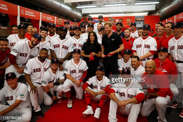 Prince Harry Duke of Sussex and Meghan Duchess of Sussex pose for a group photo with the Boston Red Sox before a game against the New York Yankees at...