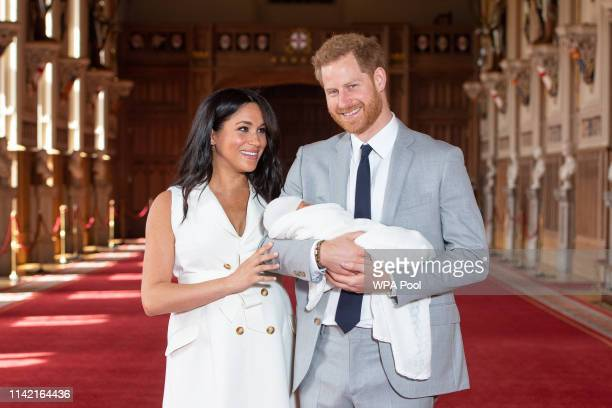 Prince Harry, Duke of Sussex and Meghan, Duchess of Sussex, pose with their newborn son Archie Harrison Mountbatten-Windsor during a photocall in St...