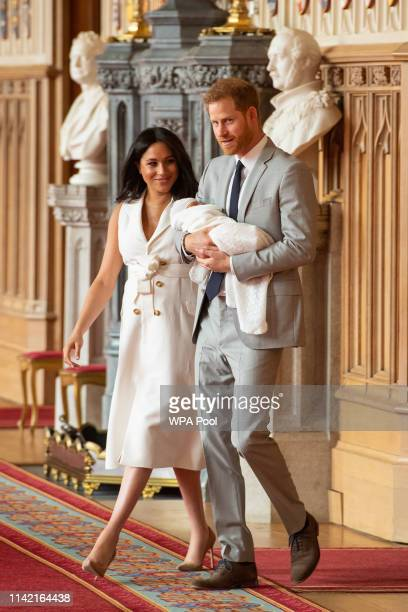 Prince Harry Duke of Sussex and Meghan Duchess of Sussex pose with their newborn son Archie Harrison MountbattenWindsor during a photocall in St...