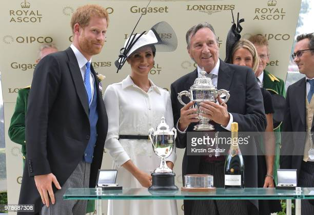 Prince Harry Duke of Sussex and Meghan Duchess of Sussex present the winners cup to breeder John Gunther after his horse Without Parole ridden by...