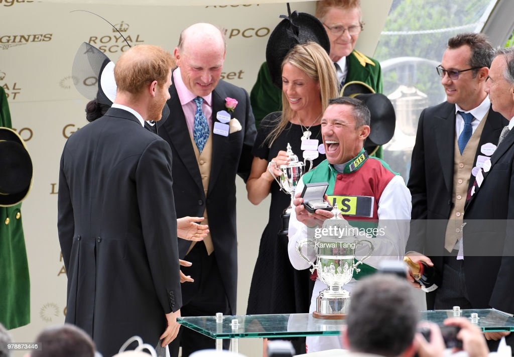 Prince Harry, Duke of Sussex and Meghan, Duchess of Sussex present the trophy for the St James's Palace Stakes to winning jockey Frankie Dettori during day one of Royal Ascot at Ascot Racecourse on June 19, 2018 in Ascot, United Kingdom.