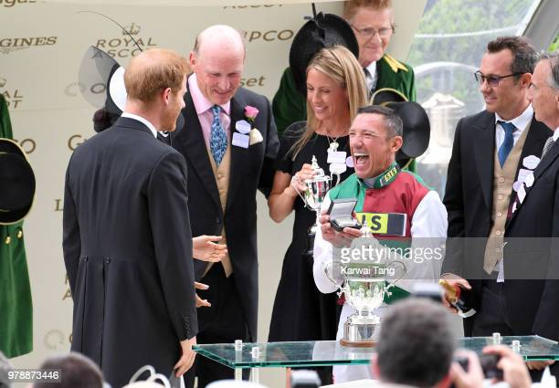 Prince Harry Duke of Sussex and Meghan Duchess of Sussex present the trophy for the St James's Palace Stakes to winning jockey Frankie Dettori during...