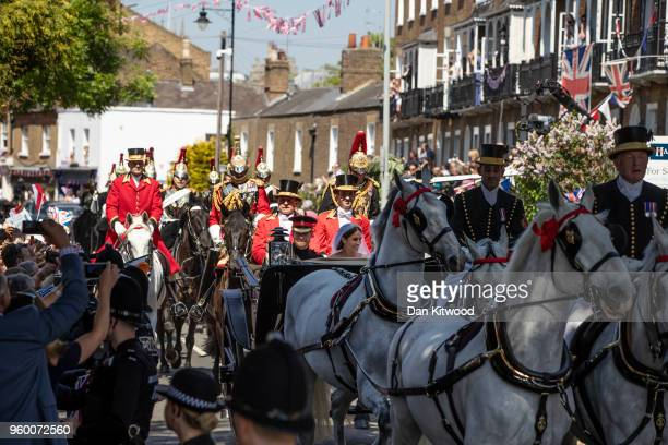 Prince Harry Duke of Sussex and Meghan Duchess of Sussex process through Windsor in the Ascot Landau carriage after getting married at St Georges...