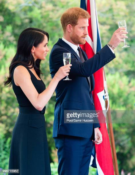 Prince Harry Duke of Sussex and Meghan Duchess of Sussex raise a toast as they attend a Summer Party at the British Ambassador's residence at...