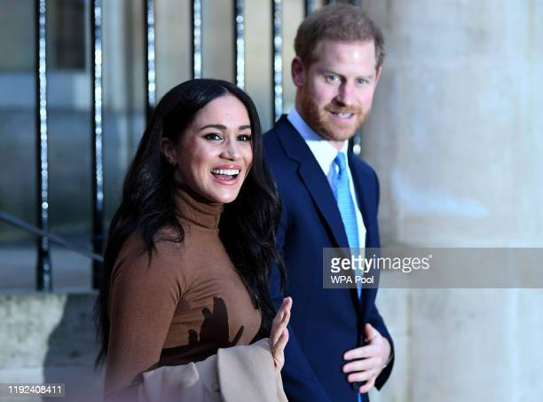 Prince Harry Duke of Sussex and Meghan Duchess of Sussex react after their visit to Canada House in thanks for the warm Canadian hospitality and...