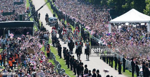 Prince Harry Duke of Sussex and Meghan Duchess of Sussex ride by carriage on the Long Walk following their wedding at St George's Chapel Windsor...