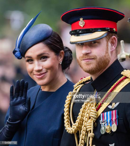 Prince Harry Duke of Sussex and Meghan Duchess of Sussex ride by carriage down the Mall during Trooping The Colour the Queen's annual birthday parade...