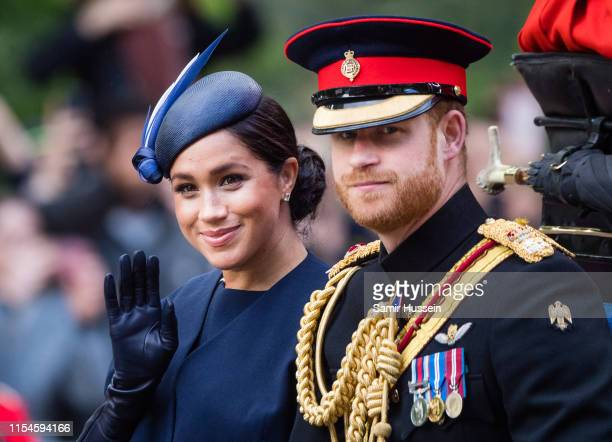 Prince Harry, Duke of Sussex and Meghan, Duchess of Sussex ride by carriage down the Mall during Trooping The Colour, the Queen's annual birthday...