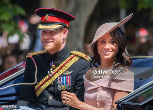 Prince Harry Duke of Sussex and Meghan Duchess of Sussex ride by carriage during Trooping The Colour 2018 on the Mall on June 9 2018 in London England