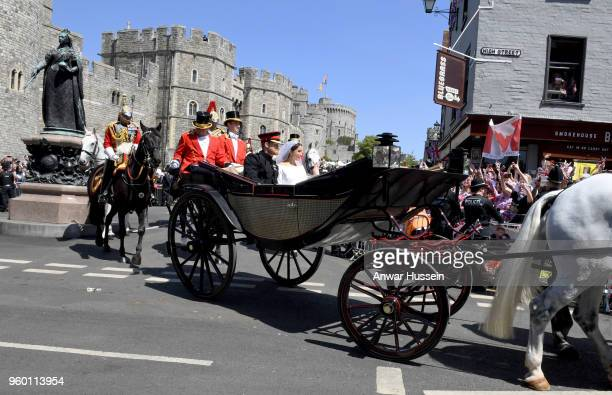 Prince Harry Duke of Sussex and Meghan Duchess of Sussex ride in the Ascot Landau open carriage during the procession following their marriage at St...