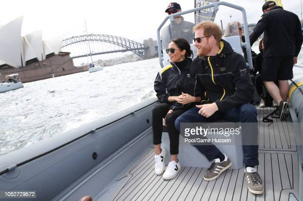 Prince Harry Duke of Sussex and Meghan Duchess of Sussex sail across Sydney harbour at Sydney Olympic Park on October 21 2018 in Sydney Australia The...