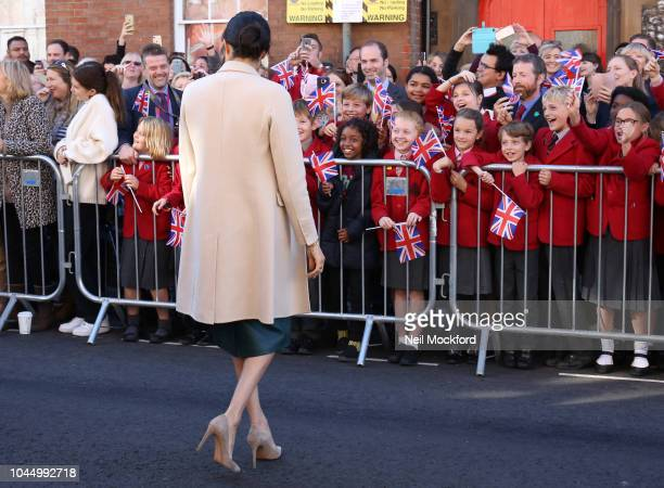 Prince Harry Duke of Sussex and Meghan Duchess of Sussex seen greeting crowds in Chichester during an official visit to Sussex on October 3 2018 in...