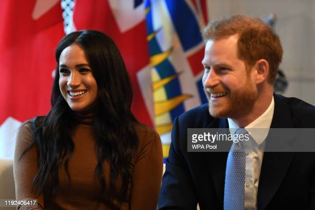 Prince Harry Duke of Sussex and Meghan Duchess of Sussex smile during their visit to Canada House in thanks for the warm Canadian hospitality and...
