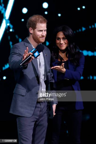 Prince Harry Duke of Sussex and Meghan Duchess of Sussex speak on stage during WE Day UK 2019 at The SSE Arena on March 06 2019 in London England