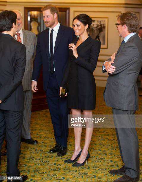 Prince Harry, Duke of Sussex and Meghan, Duchess of Sussex speak with writer Lin Manuel Miranda and others from Sentibale as they attend a gala...