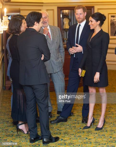 Prince Harry Duke of Sussex and Meghan Duchess of Sussex speak with writer Lin Manuel Miranda and others from Sentibale as they attend a gala...