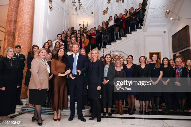 Prince Harry Duke of Sussex and Meghan Duchess of Sussex stand with the High Commissioner for Canada in the United Kingdom Janice Charette and the...