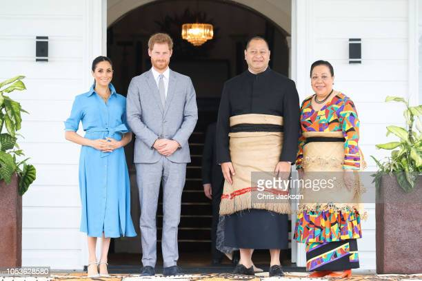 Prince Harry, Duke of Sussex and Meghan, Duchess of Sussex Standing with King Tupou VI and Queen NanasipauÔu TukuÔaho of Tonga at the farewell with...