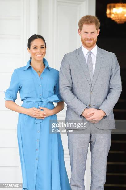 Prince Harry Duke of Sussex and Meghan Duchess of Sussex Standing with King Tupou VI and Queen NanasipauÔu TukuÔaho of Tonga at the farewell with His...