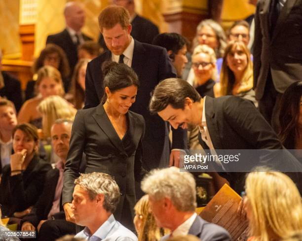 Prince Harry Duke of Sussex and Meghan Duchess of Sussex take their seat before the performance next to the writer of 'Hamilton' Lin Manuel Miranda...
