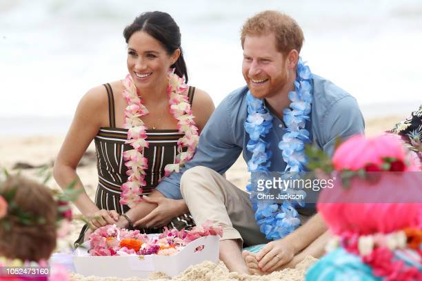 Prince Harry Duke of Sussex and Meghan Duchess of Sussex talk to members of OneWave an awareness group for mental health and wellbeing at South Bondi...