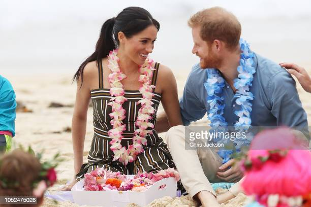 Prince Harry, Duke of Sussex and Meghan, Duchess of Sussex talk to members of OneWave, an awareness group for mental health and wellbeing at South...