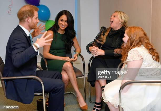 Prince Harry Duke of Sussex and Meghan Duchess of Sussex talk with Milky Sutherland and her mother Angela as they attend the WellChild awards...