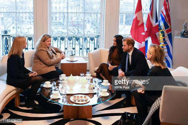 Prince Harry Duke of Sussex and Meghan Duchess of Sussex talk with the High Commissioner for Canada in the United Kingdom Janice Charette and the...
