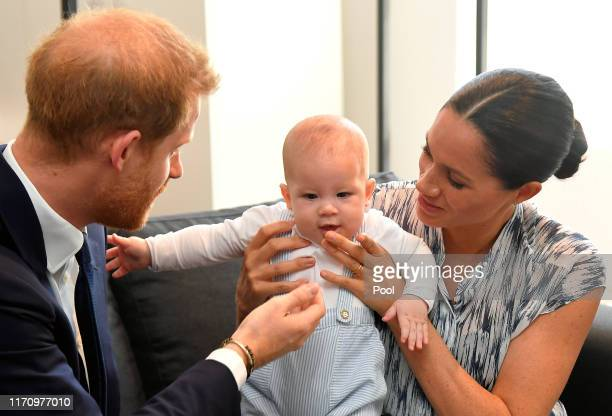 Prince Harry, Duke of Sussex and Meghan, Duchess of Sussex tend to their baby son Archie Mountbatten-Windsor at a meeting with Archbishop Desmond...