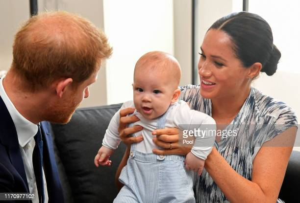 Prince Harry Duke of Sussex and Meghan Duchess of Sussex tend to their baby son Archie MountbattenWindsor at a meeting with Archbishop Desmond Tutu...