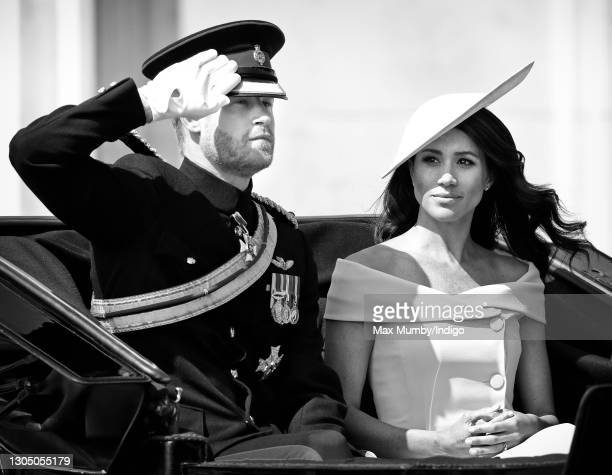 Prince Harry, Duke of Sussex and Meghan, Duchess of Sussex travel down The Mall in a horse drawn carriage during Trooping The Colour 2018 on June 9,...