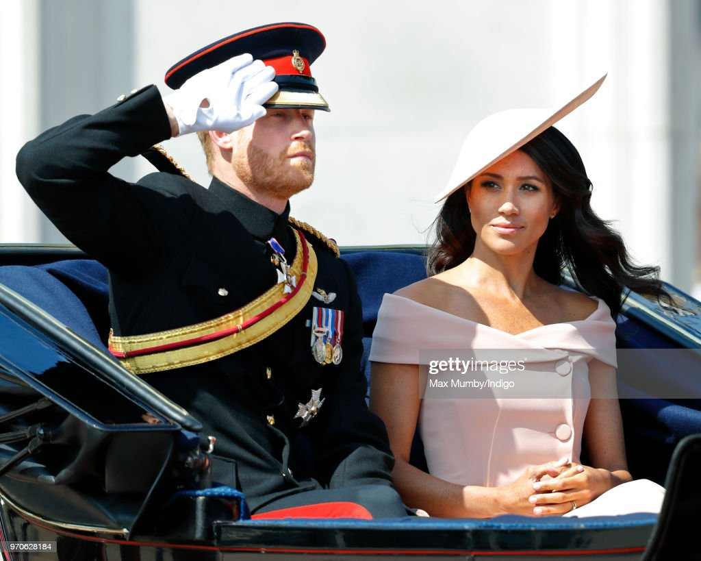 Prince Harry, Duke of Sussex and Meghan, Duchess of Sussex travel down The Mall in a horse drawn carriage during Trooping The Colour 2018 on June 9, 2018 in London, England. The annual ceremony involving over 1400 guardsmen and cavalry, is believed to have first been performed during the reign of King Charles II. The parade marks the official birthday of the Sovereign, even though the Queen's actual birthday is on April 21st.